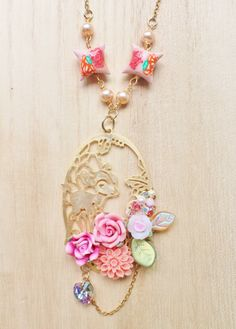 Woodland Bambi Statement Necklace - whimsical jewelry - bambi deer stamping, clay pillows, flower cabochon, clay roses & swarovski crystals. $36,00, via Etsy.