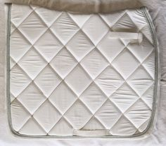 White saddle blanket with Swarovski Crystal. Full and pony size. For more information go to www.blingyourgg.com