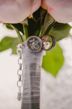 This Austin bride decorated her bouquet with a bracelet and charms - and we LOVE it! {Photohouse Films}