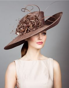 Fine straw sidesweep hat with hand made flowers and quills.