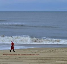 Outer Banks NC Local Artists Facebook post:  Santa strolling on Nags Head Beach,  NC Christmas morning.   Photographer credit: Barbara Ann Bell.
