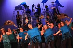 """""""Under the Sea"""" Princeton High School's March 2015 Disney's Little Mermaid Jr.  Photo (c) Jeff Schlesinger. Sea dancers in fringed tee-shirts. Clear umbrella jellyfish. Turtles and whale shark are wire forms draped with fabric/cardboard."""
