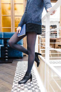 Sweater, black skirt, navy tights, booties