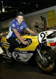 Valentino Rossi at the yamaha museum on kenny roberts old moto gp bike! Two ledgends combined!