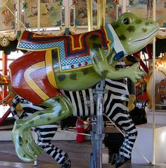Greenfield Village Carousel by Maia C, via Flickr. Herschell-Spillman made the only carousels with giant green frogs - and the only carousel animals that wear human clothes. Great Photo!