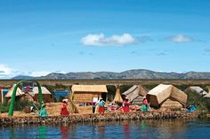 Thatched huts on the Uros floating islands in Lake Titicaca, Peru | via cntraveller.com