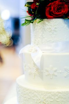 Snowflakes w/pearls and lace weddings.  Make for a stunning December wedding ;D  Add verigated sized pearls around each cake~tier.  Ditch the ribbon,add large Chrysanthemum where the bow is tied!