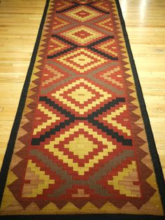 great photo of a dhurrie runner we have in our store. to see more rugs click on the photo.