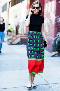A bright printed skirt and a black crop top.
