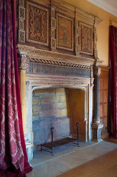 The devil is in the details of this fireplace sensation! We're loving the brick shown in the fireplace and the beauty of the mantel. Not to mention the deep red drapes! Brick Show, Renaissance, Pile Of Books, Fireplace Design, Fireplace Ideas, Old Boxes, Light My Fire, Decoration, Fireplaces