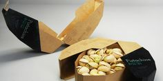 mighty nuts packaging: The result is a package where the inside tray holds pistachios but the outer part separates and becomes a tray for the shells.