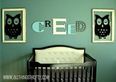 i love this whole nursery lots of good ideas. the owl frames the cool name THE TUFTED BED! best thing tutorials for all of it!!! loving it!