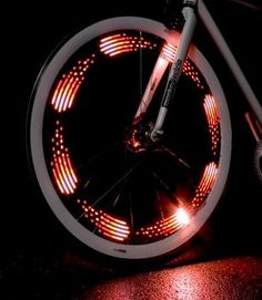 Unique and fun gift idea! The MonkeyLectric M210 Monkey Light bike wheel light attaches to spokes and displays simple, colorful graphics on the spinning bike wheel to light up the night with a highly visible display.
