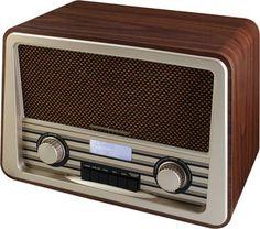 Laat de 50-er jaren herleven. Deze stijlvolle retro radio combineert een retro…