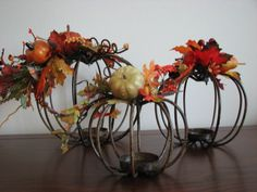 These pumpkins are a heavy gauge wire with a candle holder at the base that I added a small floral arrangement to that allows you to see the candle ( a battery operated version is a must for safety ).They would add a rustic fall touch to your decor and will look pretty whether displayed as a group or separately. They are listed individually but if you are interested in purchasing them as a set please contact me and I will quote you a price for the group as well as a shipping cost.  Large…