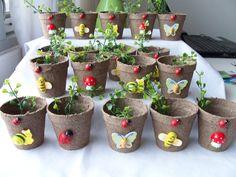 18 Miniature garden themed favour pots - party favours - garden party peat pots - ladybug, butterfly, toadstool, snail, bumblebee favours. $ 22.00, via Etsy.