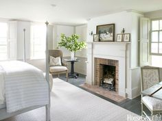 Fireplace in a neutral master bedroom. Design: Charles O. Schwarz III