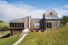 This house is both rustic and modern.  The angular boxes of its structure make it modern, but the weathered barn board cladding and corrugated steel roof give it a rustic farm feel