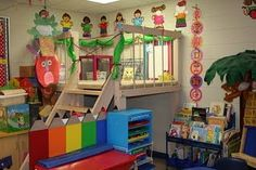 If I had the room, I would love this in our homeschool....reading corner below and play area on top.