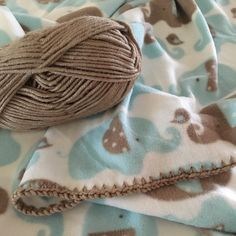 Newest crochet edge fleece.  Love the colors and the elephants! Coming soon