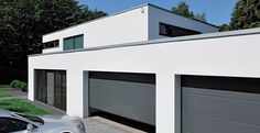 Capital Garage Doors are a leading garage door suppliers in the UK. Offering a large selection of quality garage doors at low trade prices. Double Garage Door, Modern Garage Doors, Modern Front Door, Architecture Design, Sectional Garage Doors, Carport Designs, Villa, Construction, Exterior Design