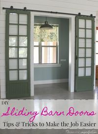 DIY double sliding barn doors - where to buy budget friendly barn door hardware, how to restore paint covered knobs and hinges, how to paint around panes of glass, and much more!