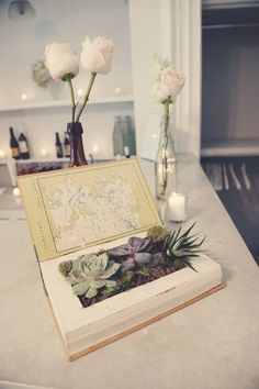 The use of old books as flower holders could be very interesting, especially if a library is a venue possibility