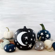 DIY Moon and Stars Pumpkins DIY Moon and Stars Pumpkins made using star craft punches and hologram vinyl! Such a fun way to decorate your pumpkins – and front porch – for Halloween! Diy Halloween, Happy Halloween, Halloween Inspo, Holidays Halloween, Halloween Pumpkins, Halloween Decorations, Homemade Decorations, Diy Pumpkin, Pumpkin Carving