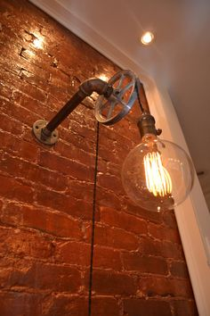 DESCRIPTION:  This industrial light is flexible enough to work in a home, retail space, or office. This light uses our custom steel pulley wheel combined with vintage cloth wire to hang the light. From the wall to the end of the pulley is 8 (this can be customized just let us know and we will make you a custom listing). Each Pendant comes with 8 (this can be customized also ) of vintage twisted wire so you can hang the light as high or low as you want. There is also an on/off switch so you…