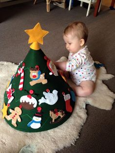 Felt tree & ornaments for toddlers - DIY http://cheriebobbins.blogspot.com.au/2014/11/soap-sandwiches-and-conical-tree.html --Felt toddler Christmas tree w traffic cone base: http://mothersniche.com/toddler-felt-tree-tutorial/ -- More: http://www.joann.com/makers-guide-playtime-childrens-tree/3565881P89.html