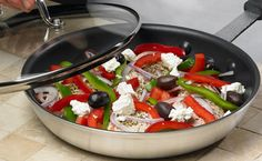 Easy Greek Chicken - - - 4 boneless, skinless chicken breasts, 2 crushed garlic cloves, 2 tsp Epicure's Greek Seasoning, 2 diced Roma tomatoes,  1 sliced small red onion, 1 sliced red and green pepper, 1/2 cup olives  1 cup feta cheese . . . . . . . . . . .    Preheat oven to 350° F. Place chicken in a single layer in frying pan. Layer ingredients over the chicken in the order listed above, ending with feta cheese. Bake covered 20 minutes. Uncover, continue cooking for 15 minutes.