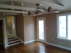 Hardwood floors and  an open beam ceiling