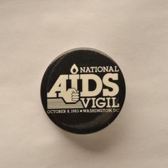 """Blog Post: The AIDS Quilt, a Memorial. Learn about how families affected by the AIDS virus have shared their experiences through art. Image: Button with """"National AIDS Vigil"""" text in white on black background"""