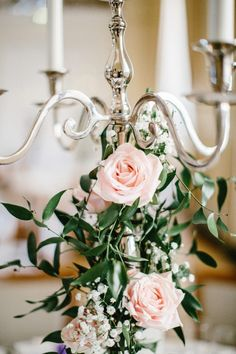 Candelabra Covered in Roses - Beauty & The Beast Themed Elegant Wedding At Farnham Castle with Bride in Christine Dando And Images by Jacob & Pauline