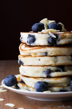 Extra Fluffy Blueberry Almond Pancakes- by sweetpeasandsaffron: Greek yogurt makes these pancakes so thick and fluffy! #Pancakes #Blueberry #Almond