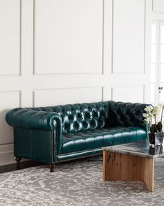 """Handcrafted Chesterfield sofa. Hardwood frame. Leather upholstery. Suspended coil-spring system and mortise-and-tenon frame construction for lasting comfort. 94""""W x 38""""D x 31""""T. Seat, 74""""W x 24""""D x 20"""