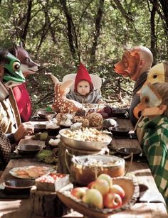 Sweet Paul Magazine - Woodland First Birthday hilarious kid party with everyone in weird animal masks at the table and the slightly scared looking gnome at the end, in his pointy red cap!
