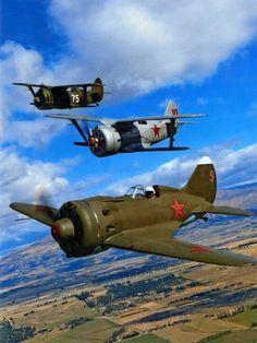 A pair of Polikarpov I-3s, circa 1938, and an I- 15, circa 1938-1943. Soviet era fighters designed by Nikolai Polikarpov.