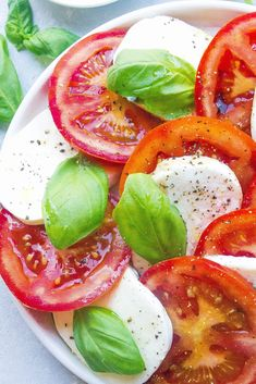 This Easy Caprese Salad makes a beautiful appetizer and takes minutes to assemble. Made with deliciously flavorful and fresh ingredients! #caprese #tomatocaprese #salad #fresh #capresesalad #easyrecipe #healthy