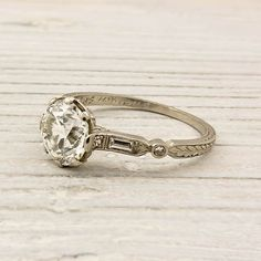 Vintage wedding ring. I love how the band is unique, and not to over the top. It has the perfect balance of diamond and silver!
