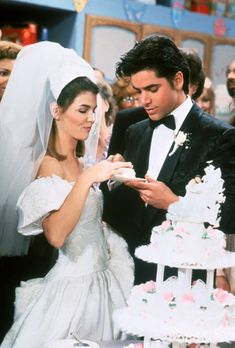 While we could spend many minutes harping on our inappropriate childhood crushes on Uncle Jesse, we must discuss his longtime beau Becky's gown: The puffed off-the-shoulder sleeves and sky-high veil make for the best '90s wedding ever.