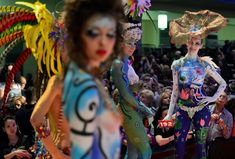 "Models wait for the rating of the jury during the ""Body Painting"" contest of the OMC Hairworld World Cup on May 4, 2014 in Frankfurt am Main..."