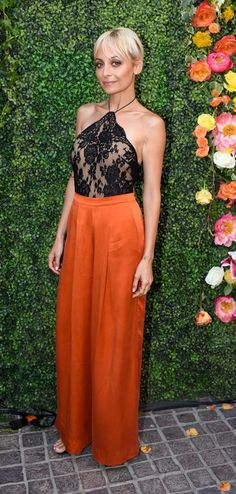 Nicole Richie accentuated her waist in a pair of high-rise wide-leg pants, which she topped off with a superfeminine lace halter.