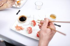 close up of couple eating #sushi at restaurant