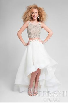 Stun the crowd at your next extravaganza in this Two Piece Rhinestone Cluster Embellished Tiered Prom Dress by Terani Couture. This chic style includes a cropped bodice that is fully embellished with clusters of rhinestones and has a matching waistba Two Piece Gown, Prom Dresses Two Piece, High Low Prom Dresses, Prom Dresses 2015, Grad Dresses, Dressy Dresses, Quinceanera Dresses, Teen Dresses, Midi Dresses