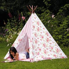 Floral Wigwam - This pretty tent makes a lovely play house for children.    It can be used outdoors in the garden, but is just as irresistible in a bedroom or playroom.    It's easy to put up, take down and store away too!    Features integral base with ties and window with flap.