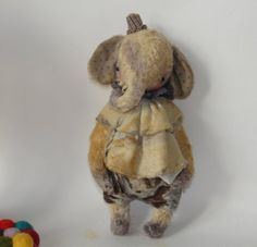 Worn but sweet little elephant - this toy has been well loved.