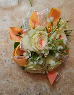 Our standard corsage with spray roses. We can do this in any color to make it unique for you.