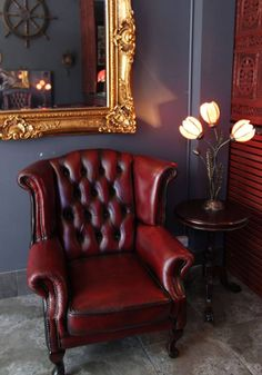 I like this chair mirror and the ship's wheel hanging on the opposing wall WA Ink Tattoo (Our recently renovated shop interior. Tattoo Studio Interior, Salon Interior Design, Interior Exterior, Tattoo Shop Decor, Shop Interiors, Classic Furniture, Tattoo Parlors, Living Room, Tattoo Flowers