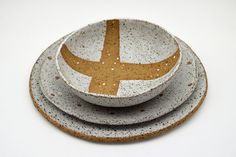 This set of three rustic, modern plates and bowl have been hand formed by me from textured, earthy stoneware clay. After shaping and drying, I